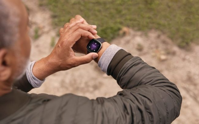Middle-aged man using a smartwatch